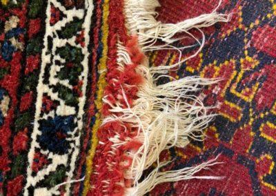 Beschädigte Teppichfransen